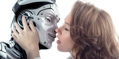 A beautiful woman kissing male robot with love