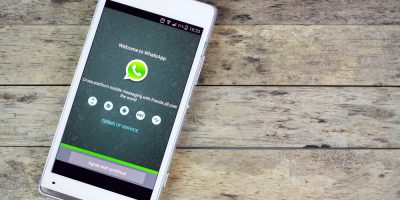 smartphone on the table and whatsapp on screen
