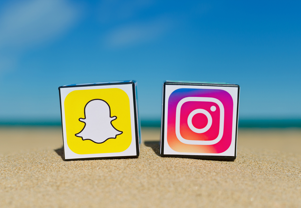 Cubes with logotypes of social media: Instagram, Snapchat