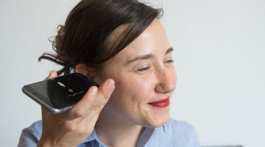 Woman listening to voice assistant